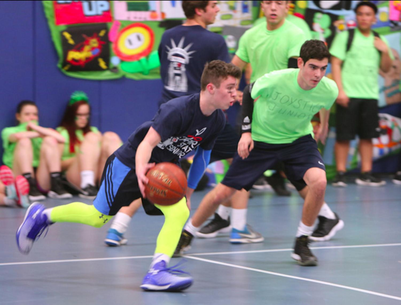 Senior Danny Friedman shows off his basketball skills during Olympics.