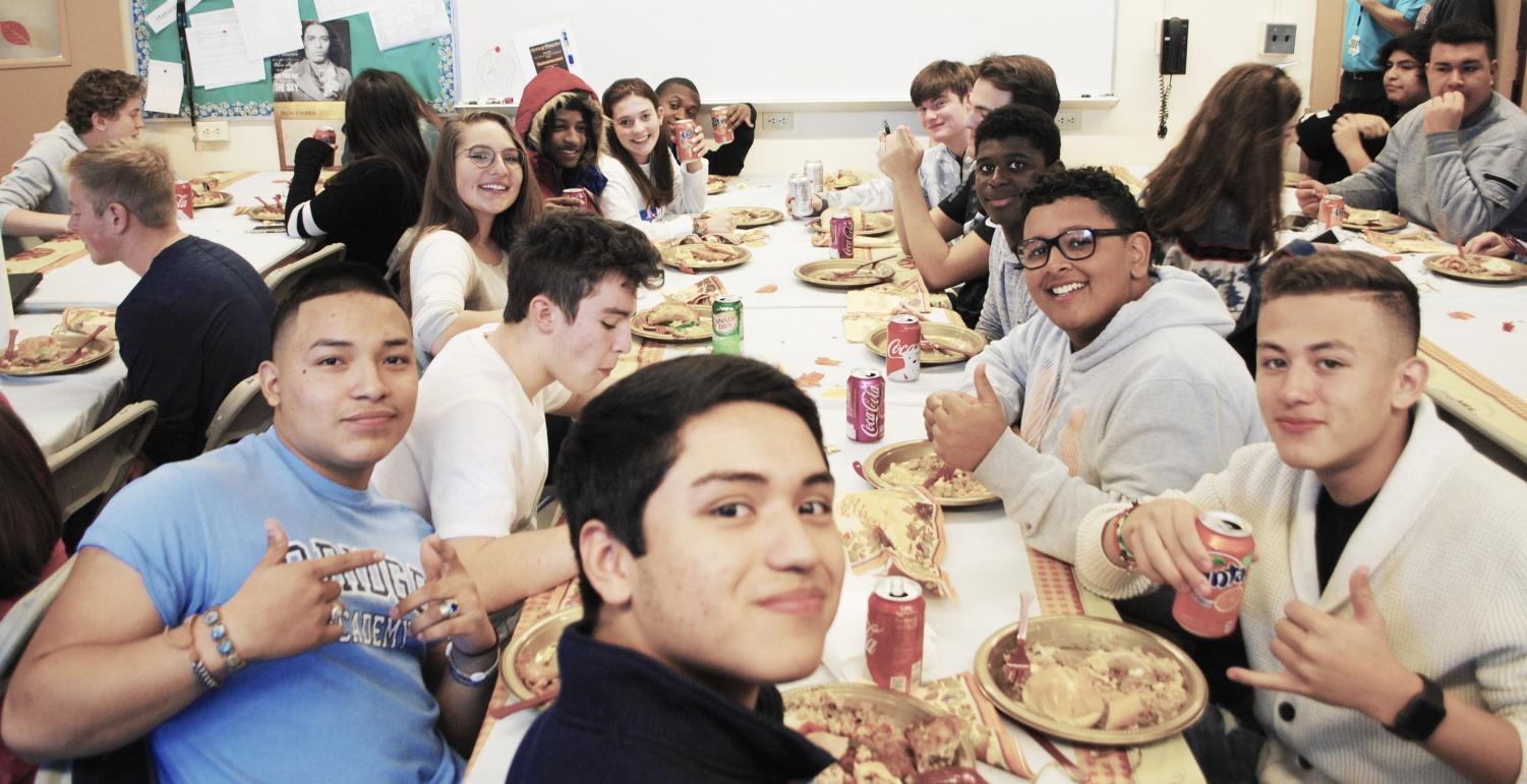 Members of the B.R.I.D.G.E. Academy celebrate Thanksgiving together.