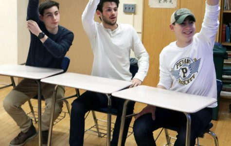 Sophomore Stephen Tahbaz (l), junior Henry Driesen (c), and sophomore Daniel Tahbaz (r) are ready to make history by jumping in with the correct answer at the 4th annual History Bowl.