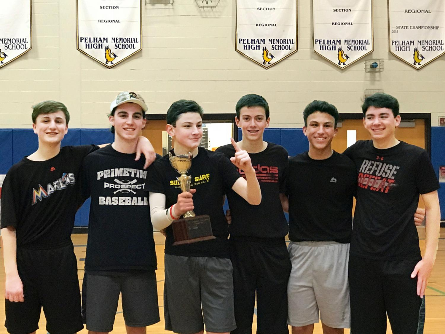 Winners of the CCC dodgeball tournament, the Purple Cobras, pose with their well-earned trophy.