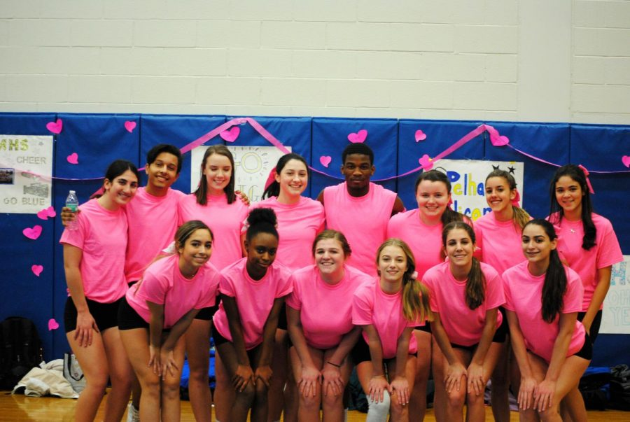 The+winter+cheer+team+gets+together+in+their+all+pink+outfits.