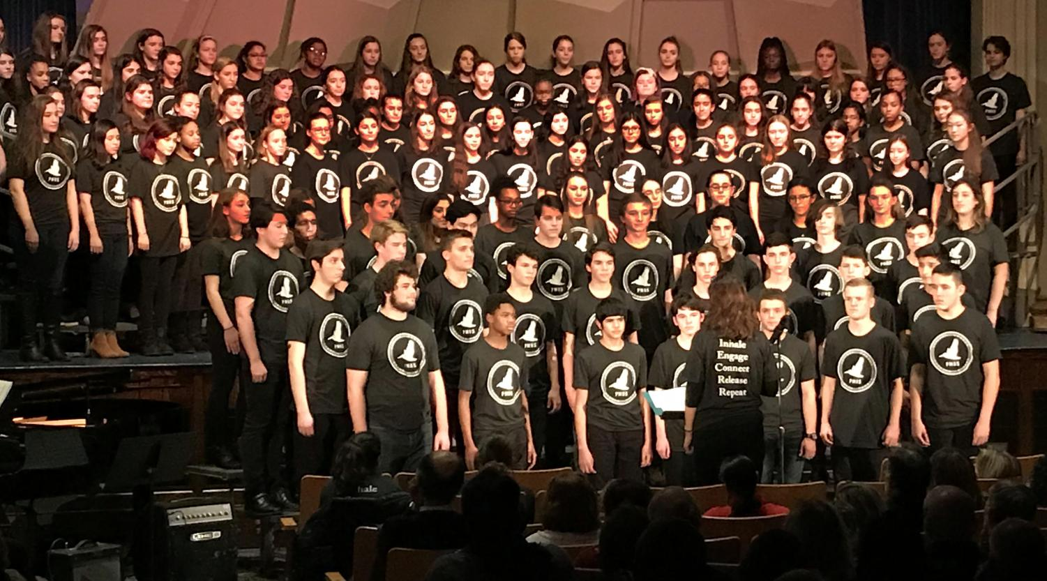 Choral Director Mrs. Maria Abeshouse leads the choir in a program of pop and Broadway songs at the fundraiser.