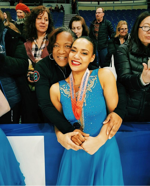 Senior Taylor Blake celebrates, alongside her mom, her qualification for the world championships.