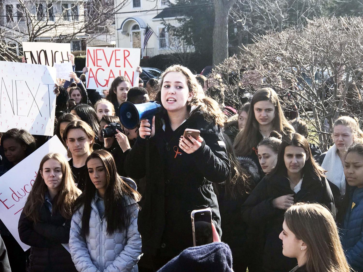 Student Leana Rutt addresses a crowd of over 200 students who participated in the walkout in support f school safety.