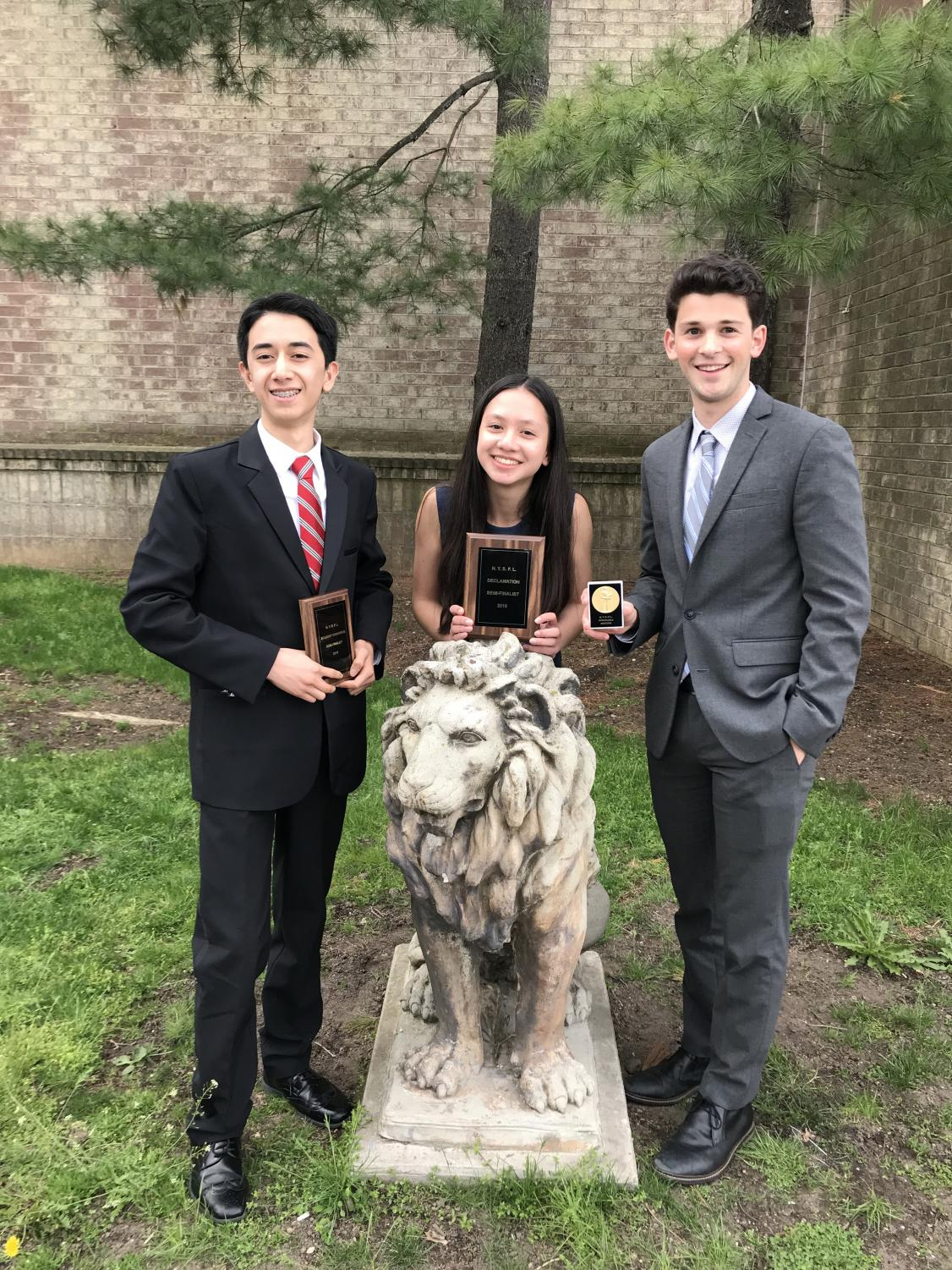 (l to r) Freshmen Isaac Blackburn and Sophia Leung, and junior Henry  Driesen celebrate their success at the NY State Championship.