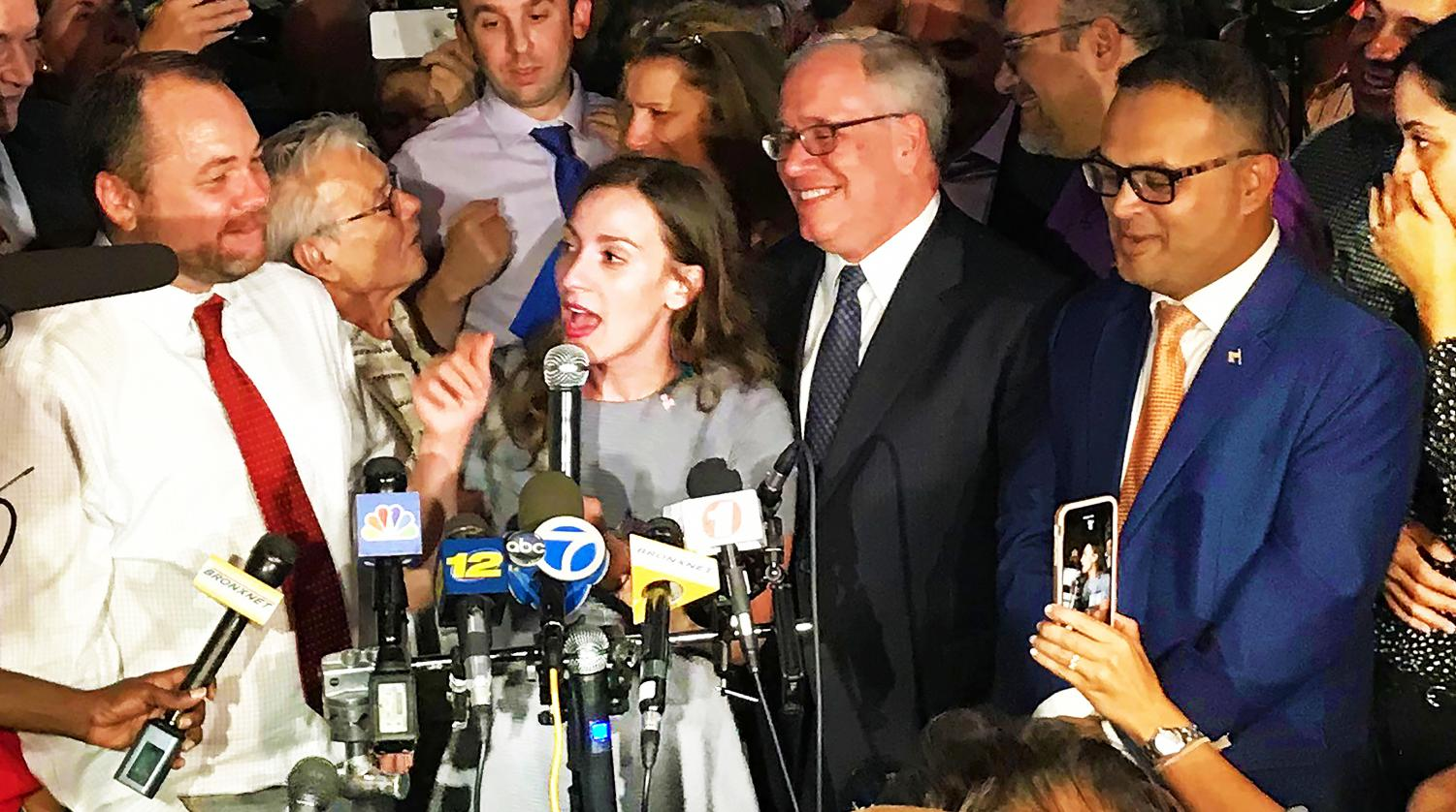 Alessandra Biaggi (c) responds to reporters following her win as the Democratic nominee for New York Senate in District 34.