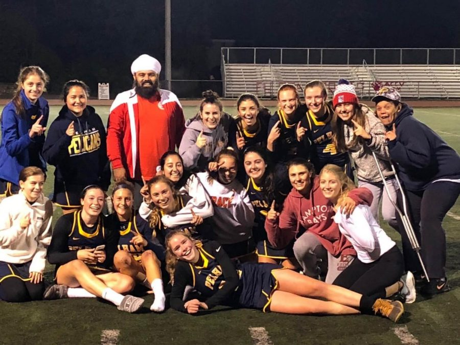 The Field Hockey team celebrates after their league victory over Rye.