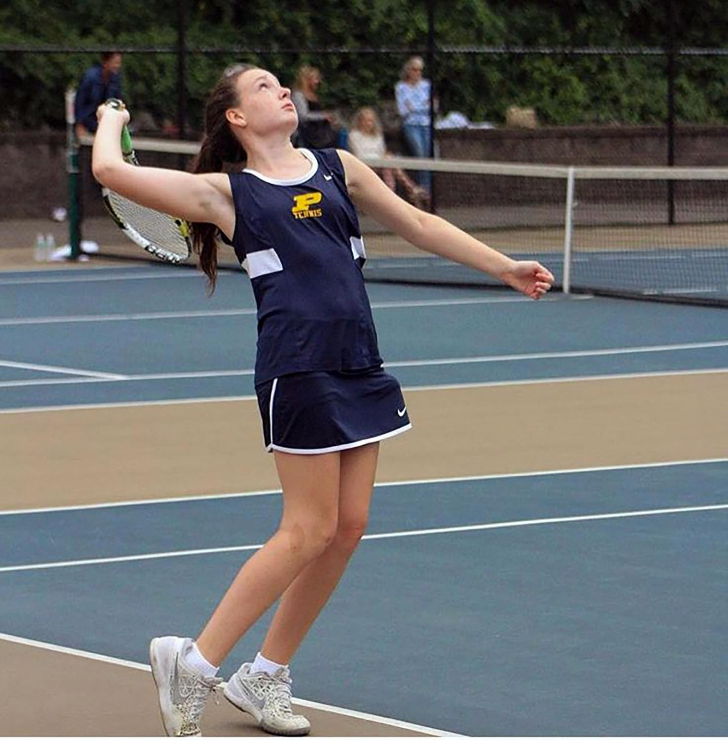 Junior Catherine Taubner serves the ball with intense concentration.
