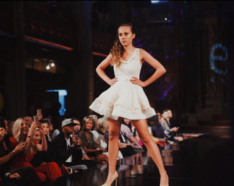 Sophomore+Julia+Corso+struts+down+the+runway+at+Art+Hearts+fashion+show.