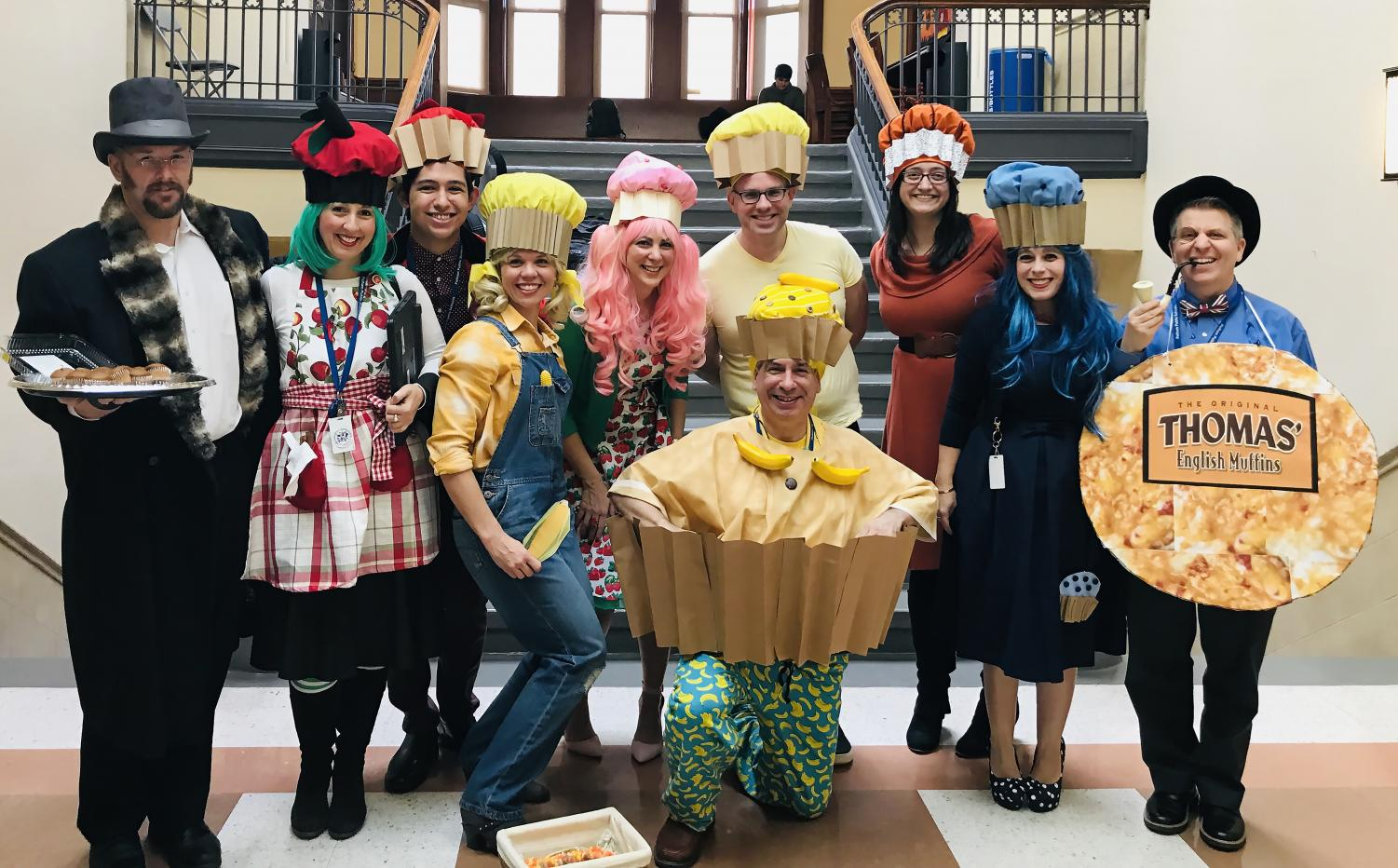 The English department in their winning guise as The English Muffins: (l to r) Mr. Powers as the Muffin Man, Ms. Wasnetsky as Apple Cinnamon, intern Eric Toruella as Red Velvet, Mrs. Kiessling as Corn, Ms. Carmody as Strawberry, Mr. Schleifer as Banana Nut, Mr. Sans as Lemon Poppy,  Ms. Strachan as Pumpkin, Mrs. O'Brien as Blueberry and Mr. Beck as an actual English Muffin.