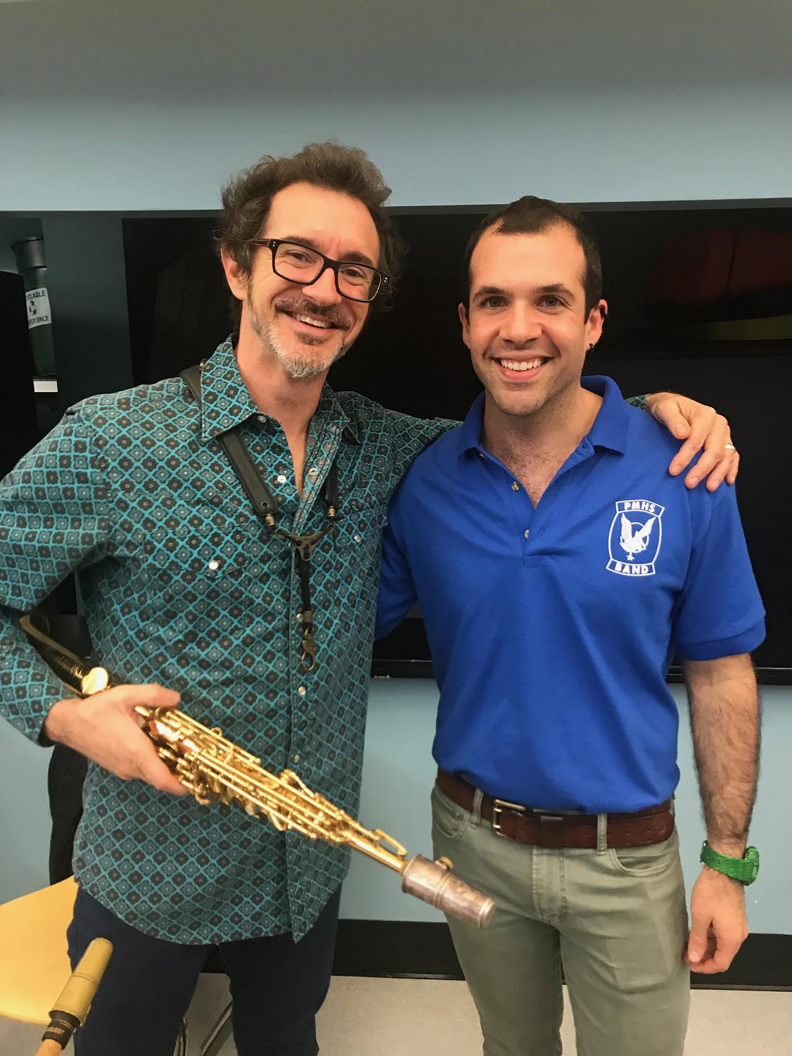 Mr. Van Bochove celebrates with musician Sean Nowell, who works with the jazz band.
