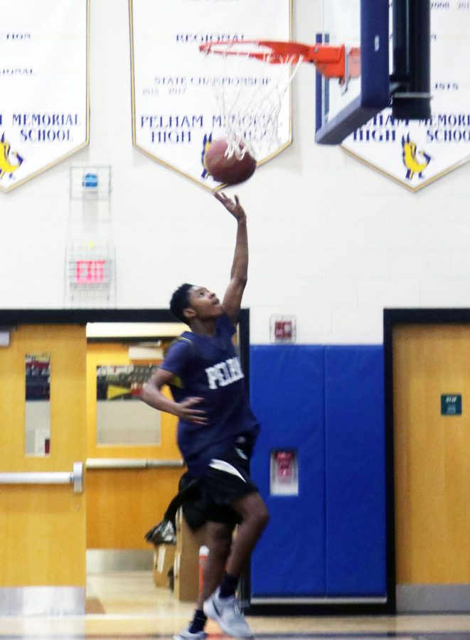 Junior Joel Hawthorne going up for a layup in practice.