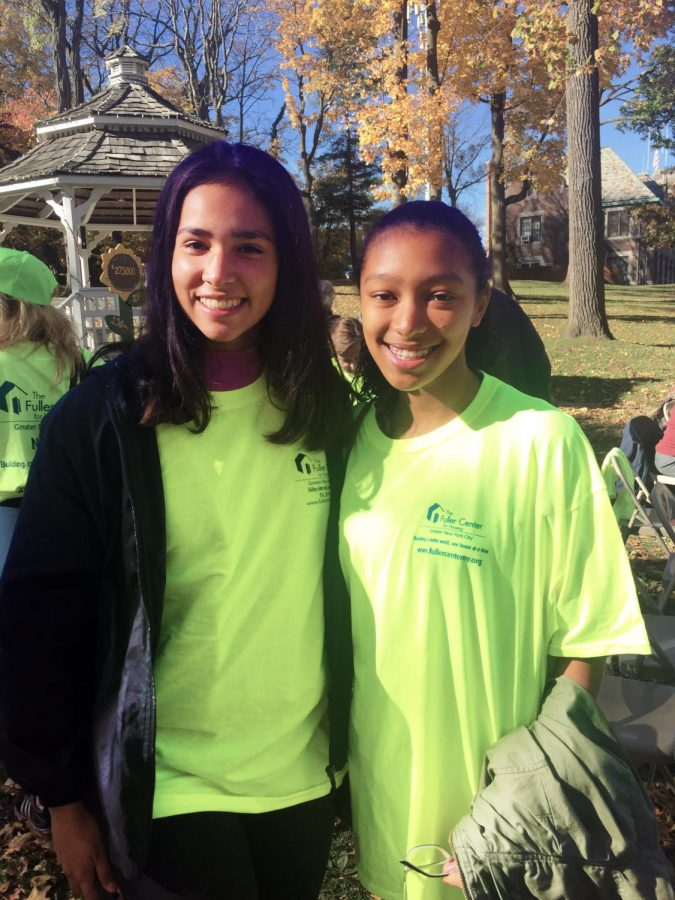 At+the+Walk+for+Homes%2C+freshman+Caroline+Michailoff+%28l%29+and+sophomore+Nadine+Leesang+%28r%29+help+raise+money+for+the+homeless.%0A