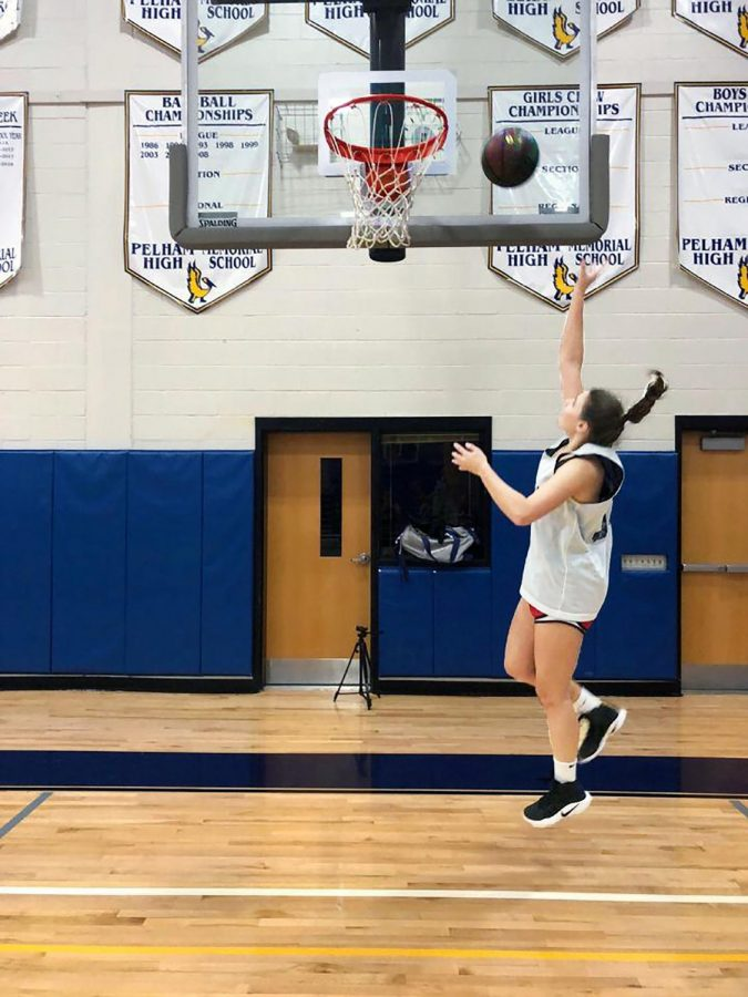 Senior+Madelyn+Dunbar+practicing+her+layups.