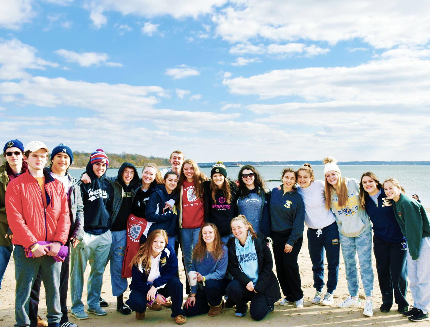 PMHS students FREEZE for a photo while getting ready to dive into the Long Island Sound to raise money for Special Olympics.