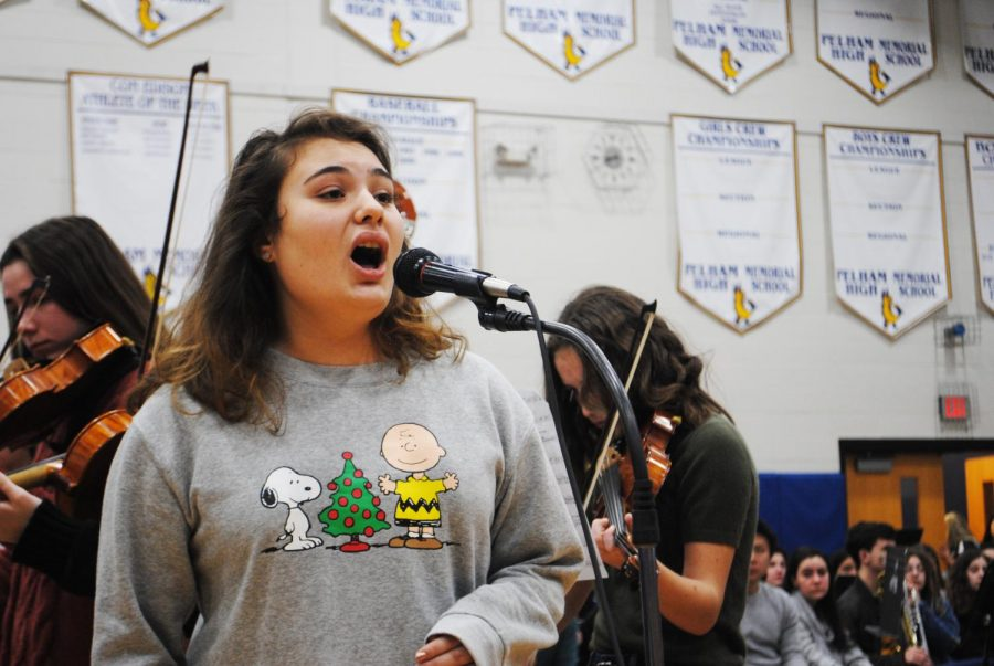 """Senior Athena Woodfin performs an aria from """"La Boheme"""" at the Winter Assembly."""