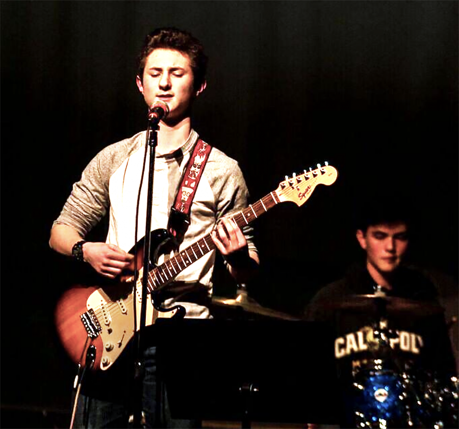 Freshman+Austin+Kelly+performs+for+his+peers+during+Battle+of+the+Bands.