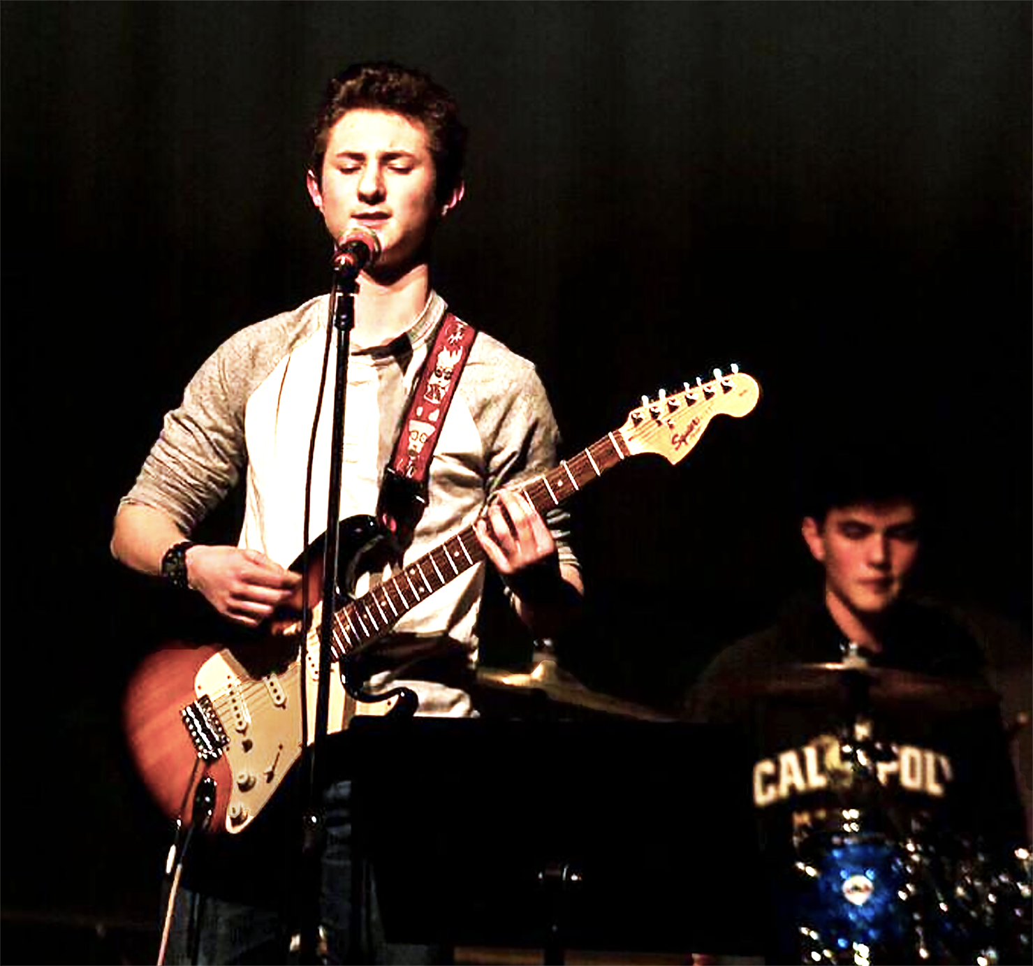Freshman Austin Kelly performs for his peers during Battle of the Bands.