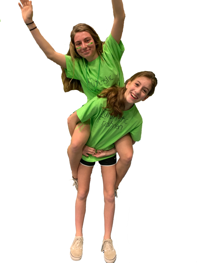 Freshman Laura Fronce  carries Samantha Janos on her back show to  demonstrate their spirit at their first Olympics Games.