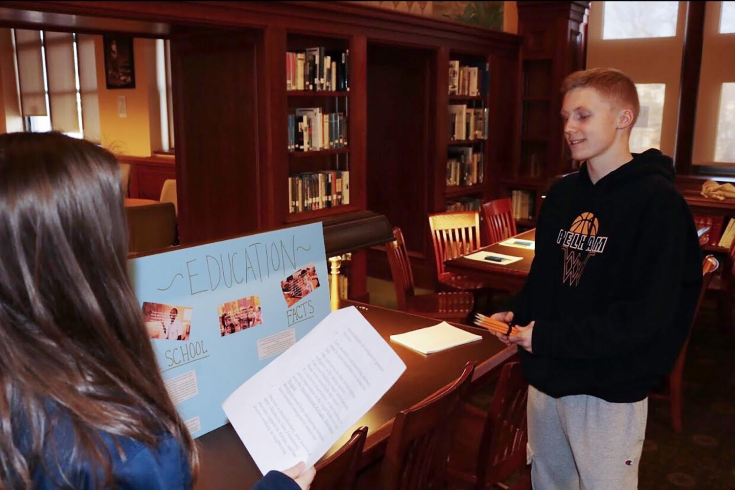 Sophomore J.P. O'Meara teaches students about the refugee experience.