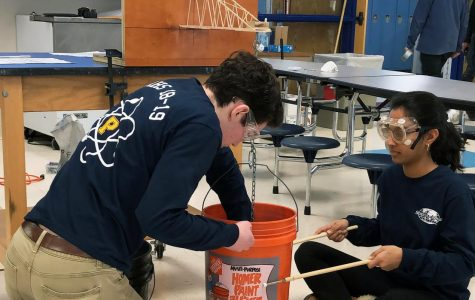 Senior Ben Glickman and junior Vedika  Basavatia test their winning Boomilever.