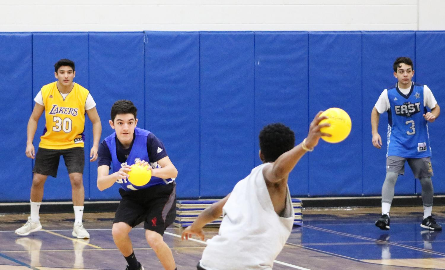 Junior Joel Hawthorne prepares to launch a ball at junior Anthony Romano.