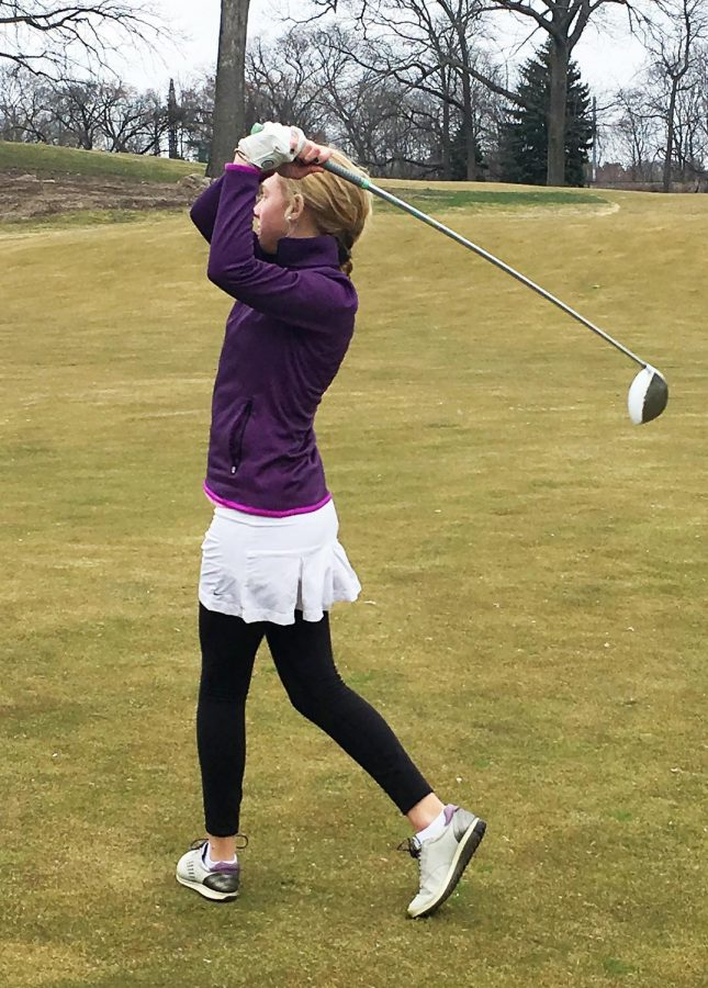 Sophomore Caroline Veteri shows off her swing on the golf course.