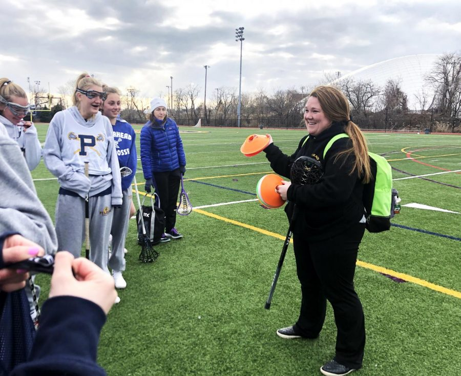 Coach Howe explains a complicated drill to the girls varsity lacrosse team.