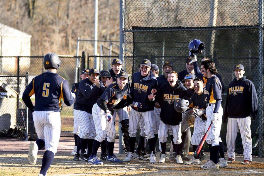 The baseball team celebrates after senior Kevin Coleman's grand slam.