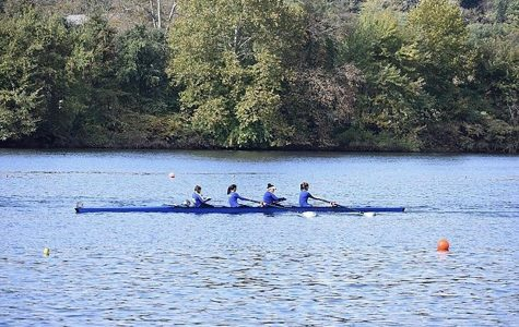 PCRA rowers glide down the river to finish their race.