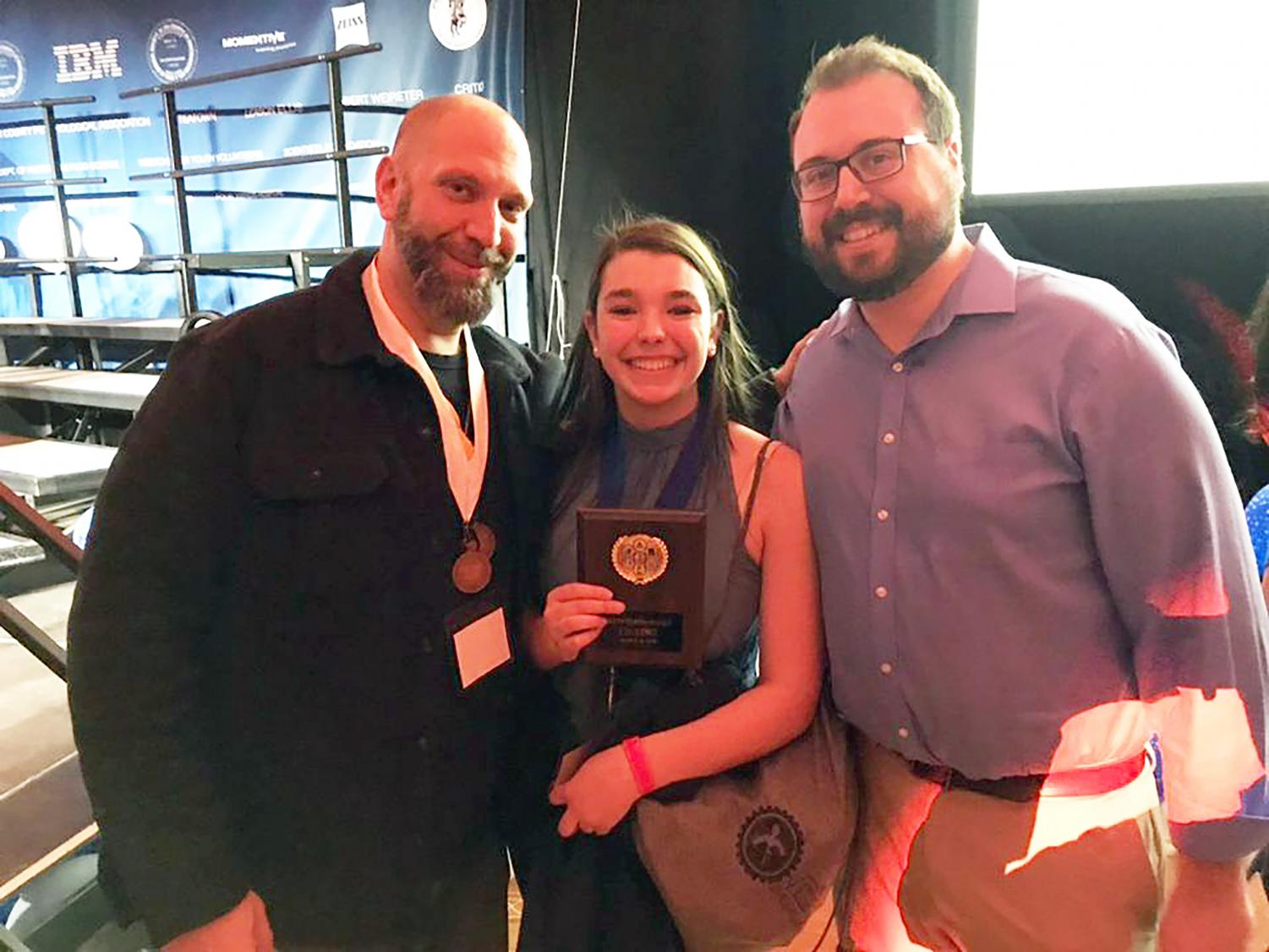 Junior Isabelle Anderson celebrates her first place win in Behavioral and Social Sciences with Mr. Beltecas and Mr. DiBello.