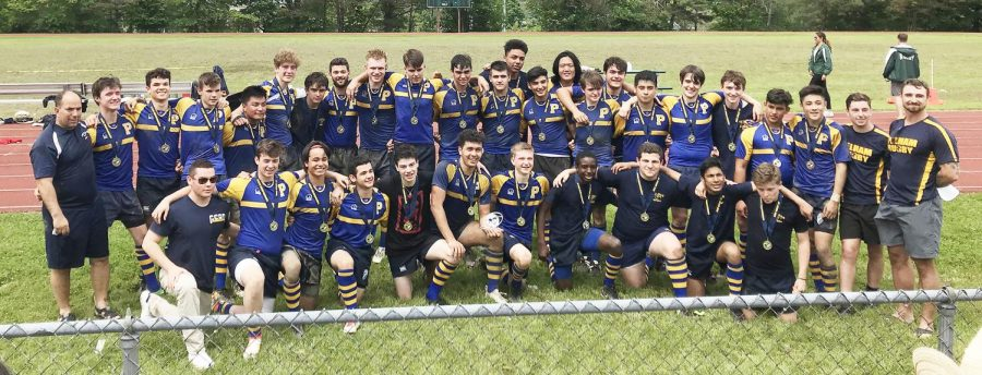 The+rugby+team+celebrates+after+making+Rye+toast%2C+and+claiming+another+state+championship.