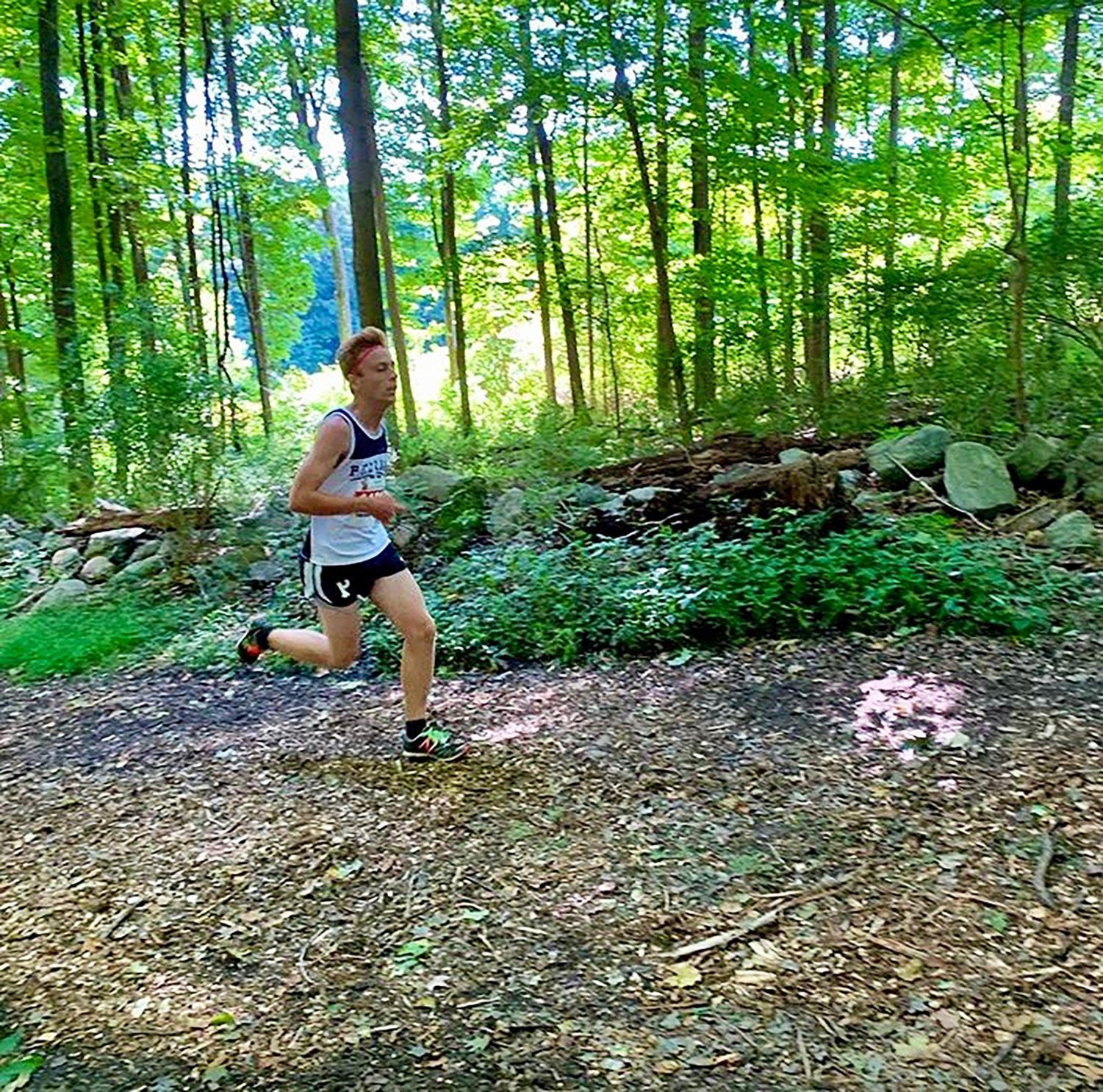 Sophomore Ben Levine chases 1st place to the finish line.