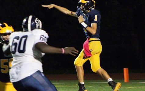 Junior Carlo Volpe launches the ball towards one of his receivers.