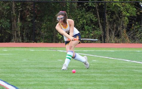 Junior Jane Dunbar lunges to make a shot on goal.