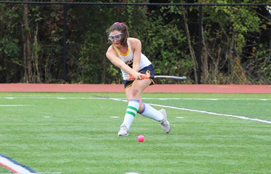 Junior Jane Dunbar lunges to make a shot on goal.