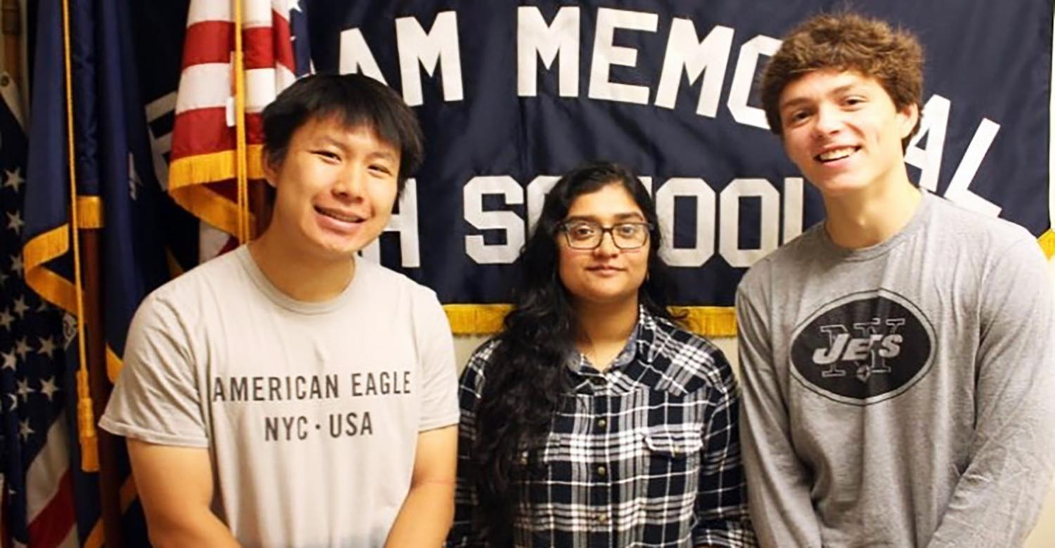 (l to r) Seniors Peter Wei, Asher Lal, and Lance Brady celebrate their achievements as National Merit Scholars.