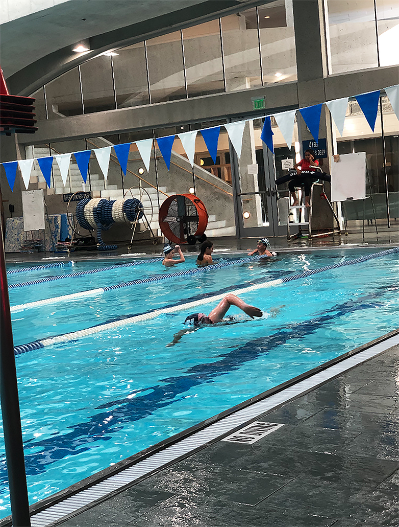 A Pelham swimmer cuts through the water in preparation for their races.