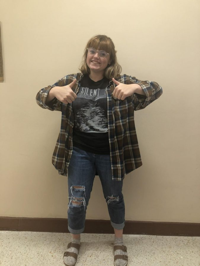 Junior Lucy Edmunds shows off her thrifted outfit.