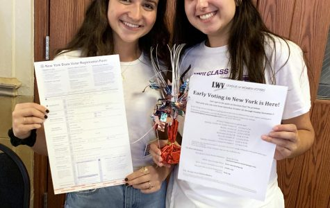(l to r): Seniors Julia O'Neil and Anna Shampanier-Bowen register student voters outside the auditorium.