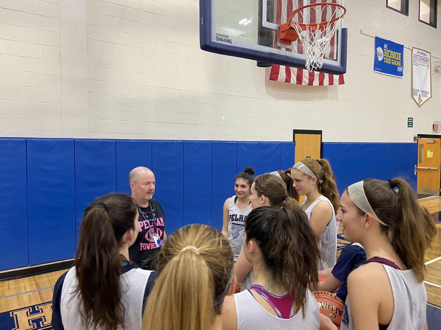 Coach Fin instructs his players during practice.