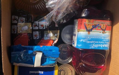 Each Thanksgiving box included food items and beverages.