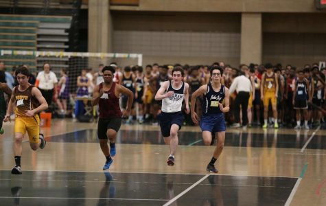 Junior Conor Matz (center) sprints ahead of his competitors.