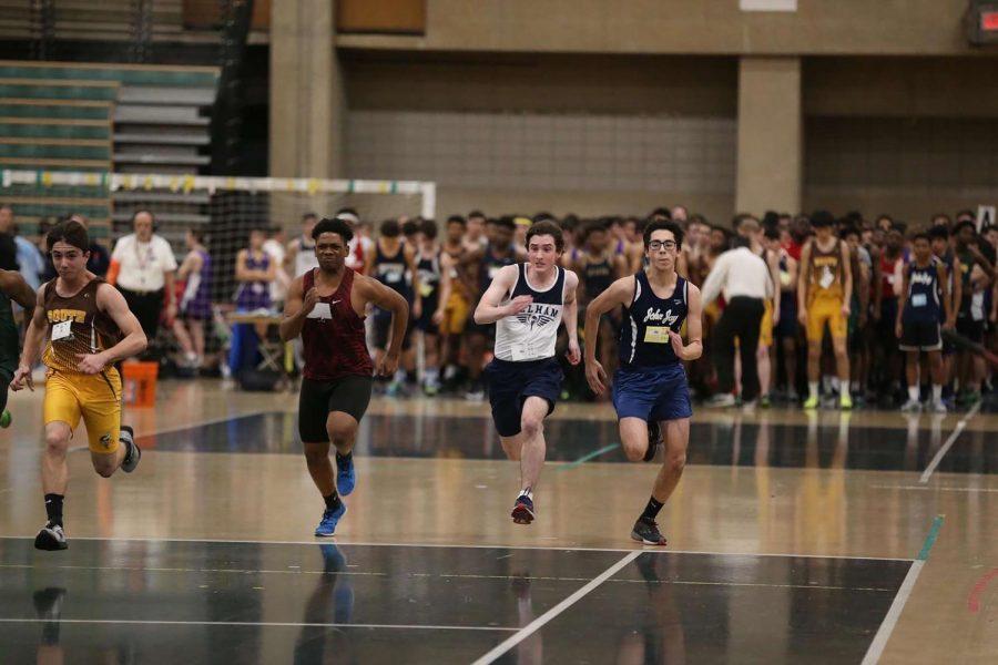Junior Conor Matz (center) sprints ahead of his competitors.
