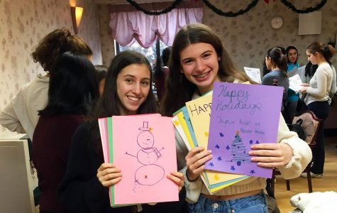 Sophomores Georgia Russello and Mikaela Lavandero show off their holiday cards for  the members of the Bayberry Care Center nursing home.