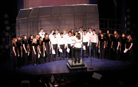 "Mrs. Abeshouse conducts the chamber chorus in a performance of ""Come Again."""