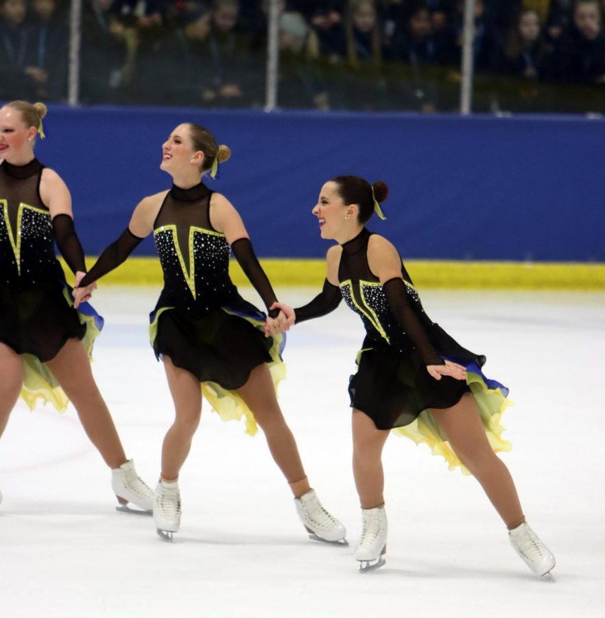 Reynolds skates in sync with her teammates.