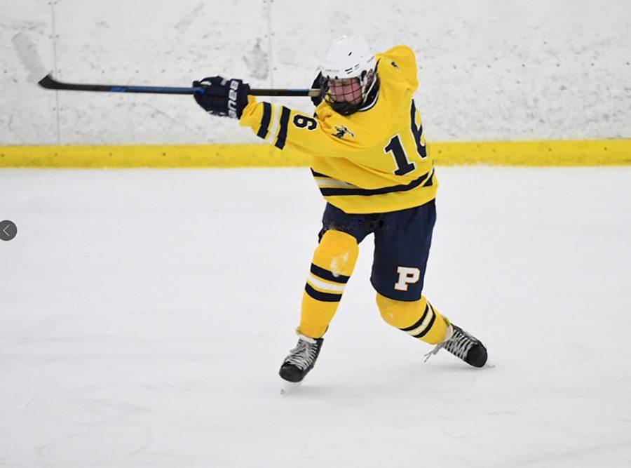Senior Nic Shotkoski fires the puck towards the net.