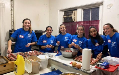 (l to r) Senior Alexis Cornachio, alumna Alyssa Marrero, Seniors SJ O'Connor, Julia O'Neil, volunteer Bri  Quintana, and Junior Emma Colkin help prepare food at Greenpoint Community Kitchen.