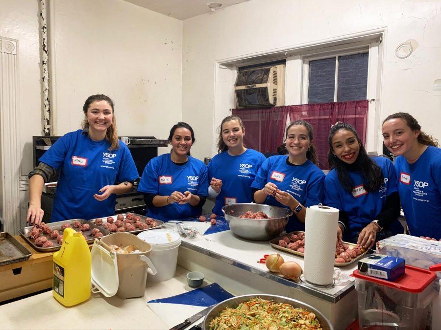 (l to r) Senior Alexis Cornachio, alumna Alyssa Marrero, Seniors SJ O'Connor, Julia O'Neil, volunteer Bri  Quintana, and Junior Emma Colkin help prepare food at Greenpoint Community Kitchen.